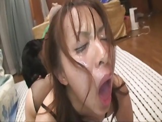 Asian girl kisses her sweet doggy on the camera